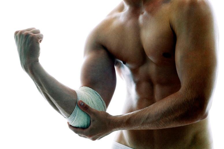 Болит локоть после тренировки: причины и методы лечения